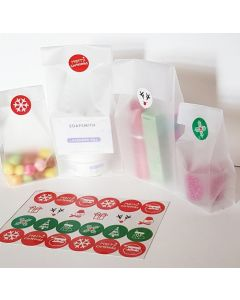 """Pack of 20 Small clear frosted block bottom sweet/party/gift bags (3"""" x 2"""" x 7"""") with assorted printed Xmas symbols sticky labels"""