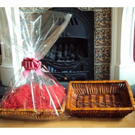 DIY Hamper kit containing Retangular wicker deli basket tray, cellophane basket bag, RED pull bow and Xmas paper shred