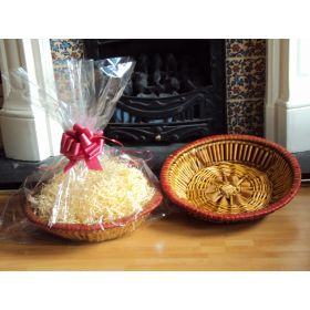 DIY Hamper kit containing Round wicker deli basket tray, cellophane basket bag, RED pull bow and paper shred
