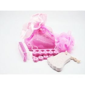 4 small bath spa items in a light pink toiletry bag with string tie (sponge, pumice stone, hand brush and toe separator)