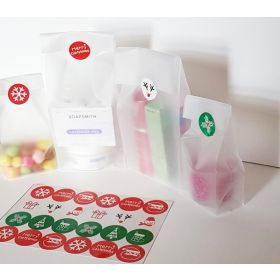 "Pack of 20 Small clear frosted block bottom sweet/party/ gift bags (4"" x 2 1/2"" x 9 3/4"") with assorted printed Xmas symbols sticky labels"