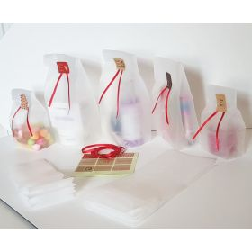 "Pack of 20  Small clear frosted block bottom sweet/party/ gift bags (4"" x 2 1/2"" x 9 3/4"") with assorted ""just for you"" sticky labels and red satin ribbon"