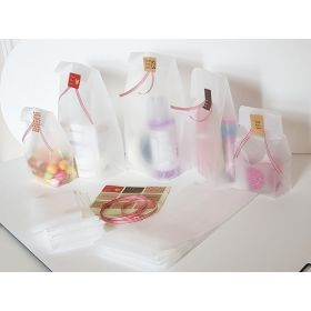 "Pack of 20  Small clear frosted block bottom sweet/party/ gift bags (4"" x 2 1/2"" x 9 3/4"") with assorted ""just for you"" sticky labels and red/white cotton ribbon"
